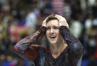 A happy Jeremy Abbott after his free skate at the 2014 World Championships in Saitama, Japan.