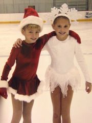 Gracie Gold (left) and Carly Gold pose on the ice as
